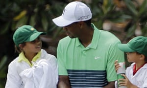 Tiger Woods with his children Sam and Charlie.