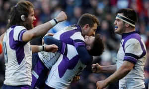 Ali Price (second right) embraces Greig Laidlaw at full-time in Scotland's dramatic win over France at Murrayfield.