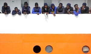 Migrants wait to disembark from Aquarius in the Sicilian harbour of Catania, Italy, at the end of May