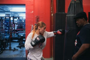 Jenna Gaglioti works the bags under the watchful eye of trainer Lennox Blackmoore.