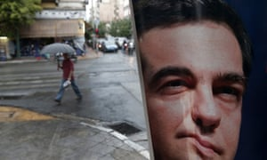 A man walks past a poster of left-wing Syriza party leader Alexis Tsipras in Athens.