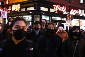 Activists participate in a vigil in response to the Atlanta spa shootings on 17 March 2021 in the Chinatown area of Washington DC.
