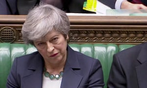 Theresa May listens in parliament