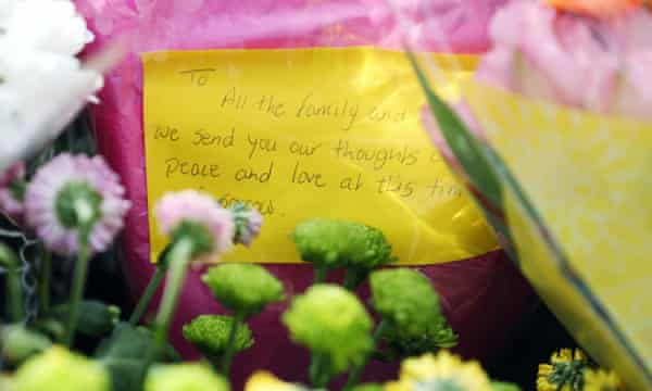A message left on one of the floral tributes.