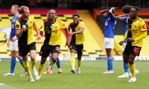 Watford's Craig Dawson (left) celebrates scoring their injury time equaliser.