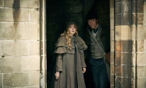Ellie Bamber (Cosette) and Dominic West (Valjean) in Les Misérables.