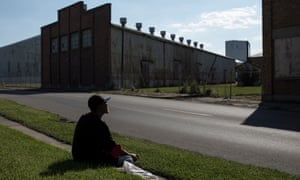 David Smith, 62 waits for a bus on W Memorial Drive, Muncie, opposite the site of the former Ball Brothers Glass Manufacturing Co