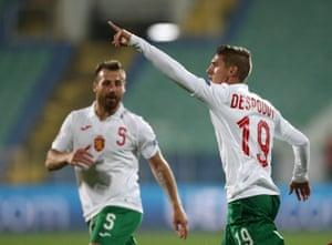 Bulgaria's Kiril Despodov celebrates scoring their first goal with Nikolay Bodurov.