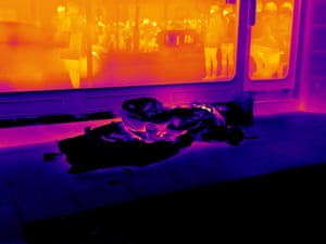 Remnants of warmth from where a man was sitting on the pavement on Cranbourn Street are clearly visible. The contrast of the cold pavement with the warmth of the restaurant window behind clearly displays the extremities of prolonged exposure to the cold. The camera doesn't penetrate glass, so the figures in the window are infrared reflections of people in the street.