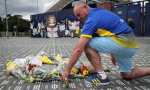 A fan lays flowers on the ground in memory of Jack Charlton at Elland Road on Saturday.