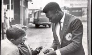 Pele signs an autograph after arriving for the game against Sheffield Wednesday, in 1962.