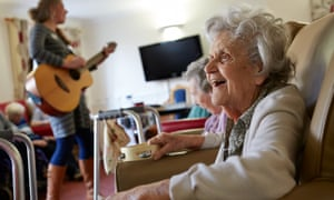 Joyce Kemeys enjoys a music therapy group session at the Homestead care home in Carterton, Oxfordshire