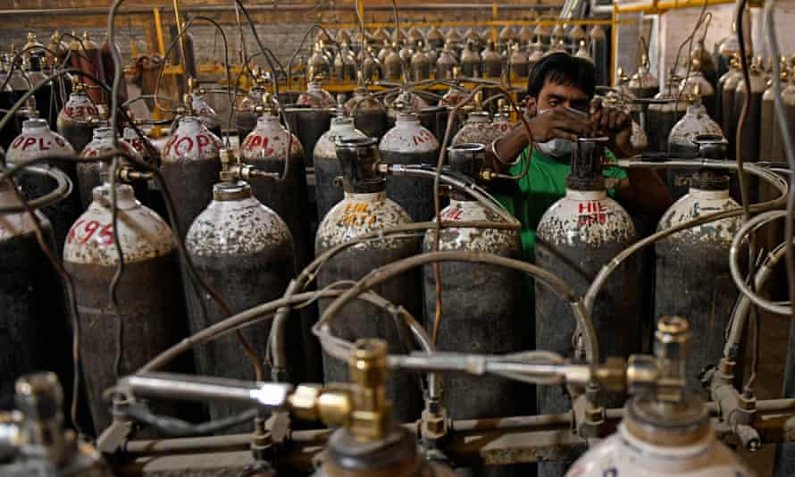 Workers sort oxygen cylinders for hospitals at a facility on the outskirts of Amritsar, India.