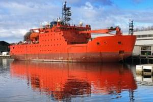 Icebreaker ship the Aurora Australis painted in International Orange, moored in the harbour in Hobart.