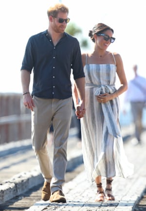 Meghan with Prince Harry, wearing a sundress by the sustainable fashion brand Reformation