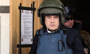 Gordon Brown wears a helmet and body armour in Afghanistan.