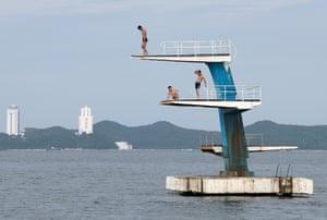 Men pause on a diving platform in Wonsan.