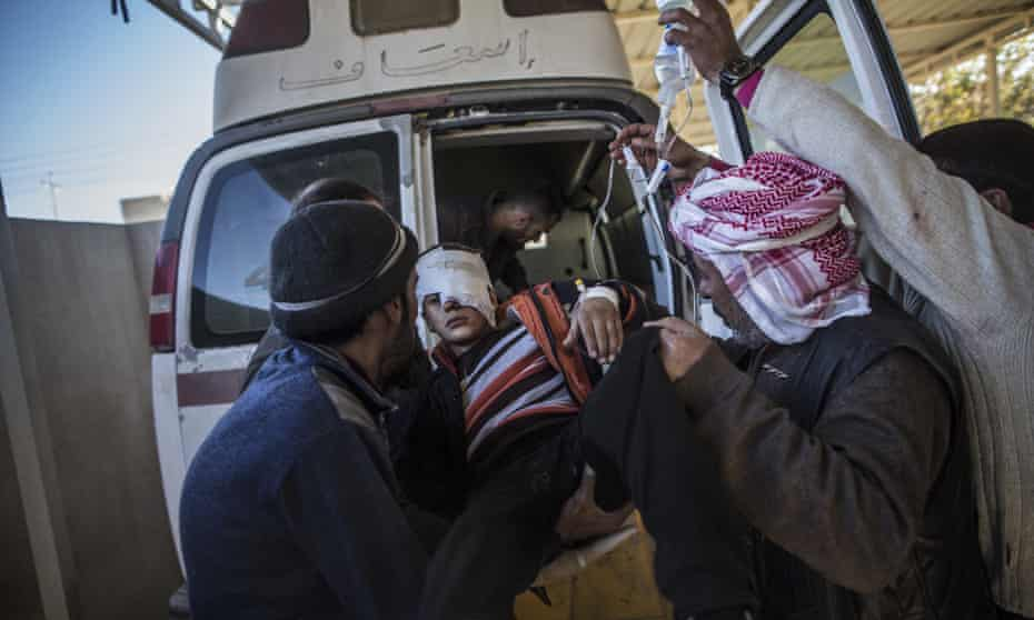 A young boy, Yousuf Odey, 10,  wounded by Isis militants is transferred to a hospital in Mosul, December 2016.