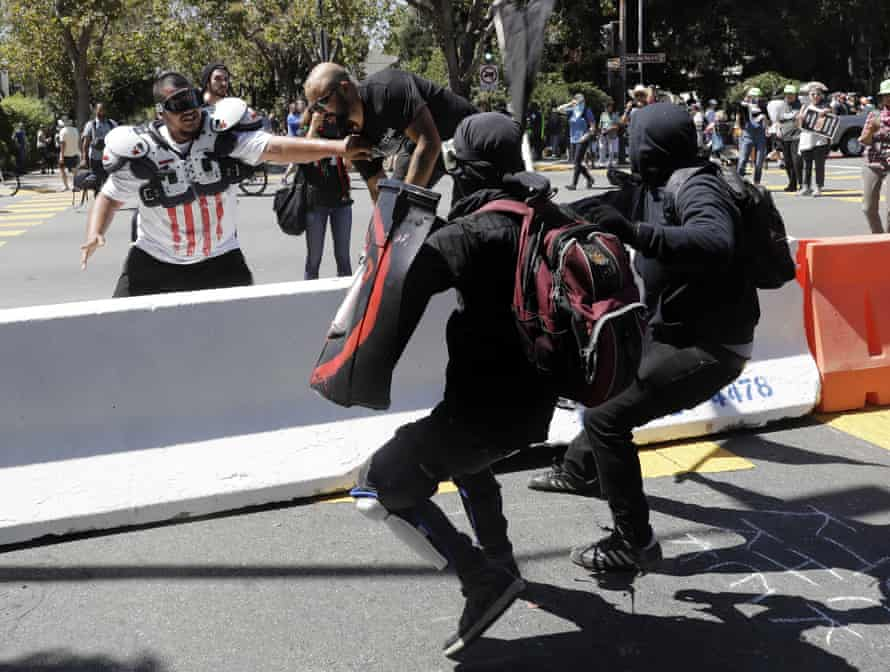 Patriot Prayer founder Joey Gibson, second left, is chased by counter-protesters in Berkeley.