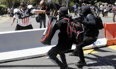 Anti-fascist protesters and a rightwing demonstrator at a rally in Berkeley.