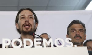 Podemos (We Can) leader Pablo Iglesias (left), speaks to supporters in Madrid.