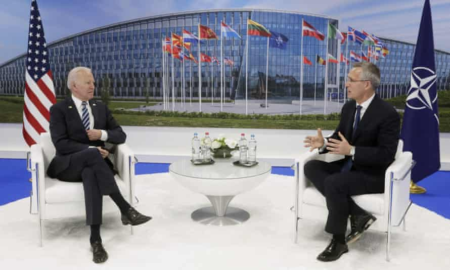 Joe Biden and the Nato secretary general, Jens Stoltenberg, meet during the summit in Brussels