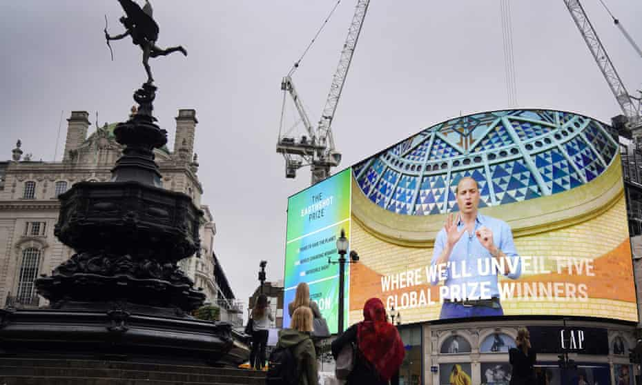 People watch as the Duke of Cambridge features in the trailer for the Earthshot prize in Piccadilly Circus, central London.