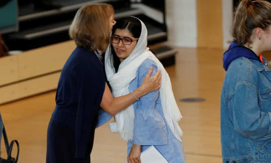 Malala Yousafzai is congratulated after collecting her A-level results at Edgbaston high school for girls in Birmingham.