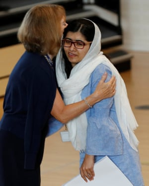 Malala Yousefzai is congratulated after collecting her A-level exam results.