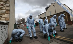 Forensic officers at a crime scene in north London.