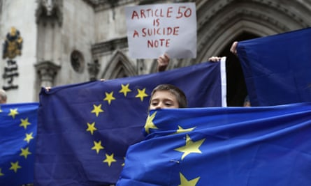 EU supporters stand at the entrance to the royal courts of justice.