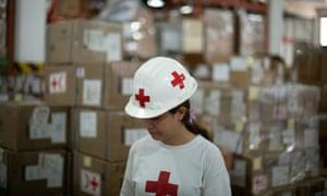 A Red Cross volunteer works in an International Committee of the Red Cross warehouse in Caracas, Venezuela