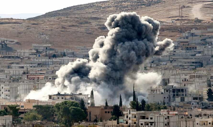 Heavy smoke rises following an airstrike by the US-led coalition aircraft in Kobani, Syria.