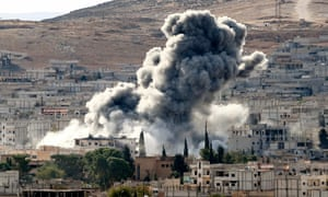 Heavy smoke rises after an air strike by US-led coalition aircraft in Kobani, Syria, during fighting between Syrian Kurds and Isis in October 2014.