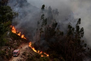 A fire spreads across the road in Monchique