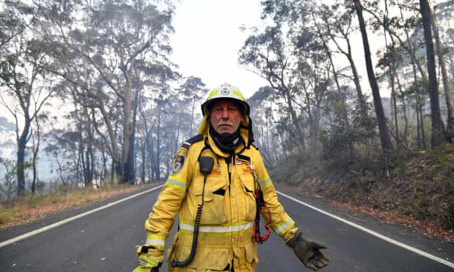 Volunteer firefighter Gary Stokes monitors bushfires close to a residential area in Dargan, 120km from Sydney.