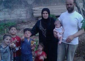Jamil and Iman with their children before the explosion that killed their eldest child, Khaled, and left another son, Hassan, so traumatised that he cannot speak.