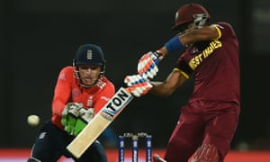 England's wicketkeeper Jos Butler keeps his eye on the ball as West Indies' batsman, Dwayne Bravo strikes out.