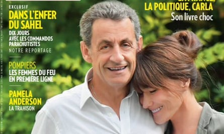 Paris Match cover has Nicholas Sarkozy towering over his wife Carala Bruni.