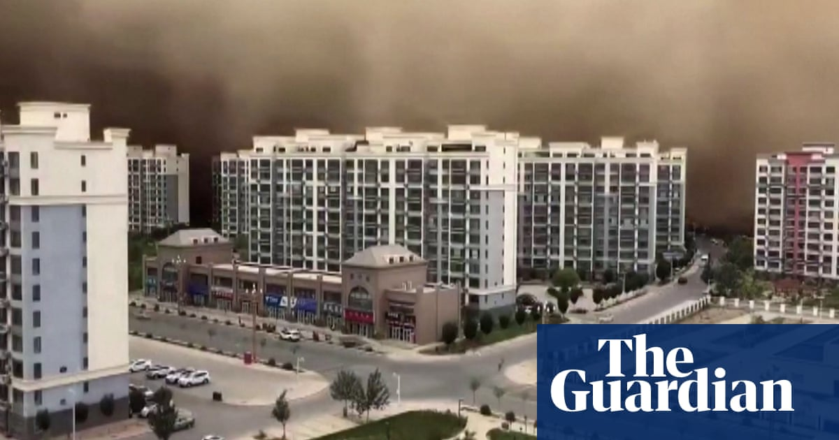 Sandstorm swallows western Chinese city in dramatic footage – video