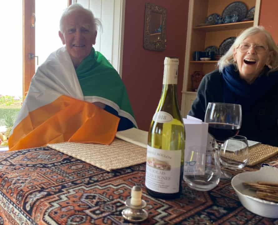 John le Carré wrapped in an Irish flag, beside his wife, 19 October 2020, his 89th birthday