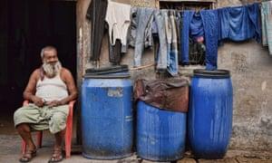 Dharavi inhabitant outside home