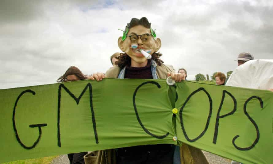 protester with a banner saying: GM crops