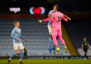 Manchester City goalkeeper Ederson (right) is congratulated by team-mate Joao Cancelo (centre) as Oleksandr Zinchenko looks on. The keeper's pass to set up team-mate Ilkay Gundogan to score their side's third goal of the game.
