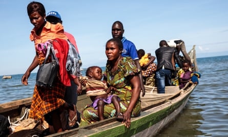 Congolese refugees arriving in Uganda, where refugees have the right to work and free movement.