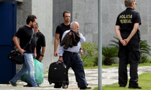 Executives of Odebrecht SA are escorted by federal police officers during their transfer to Curitiba city as they leave the federal police headquarters in São Paulo, Brazil, on Tuesday.