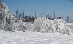 Ice and snow builds up along Lake Michigan