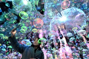 Handan, China  Immersive interactive scenes such as a mirror maze, diamond tunnel and a starry sky jellyfish lamp (pictured) are set in a museum and create a colourful dream world for visitors.