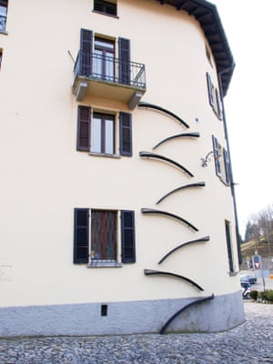 Apartment building with cat ladders in Brè Lugano, Switzerland