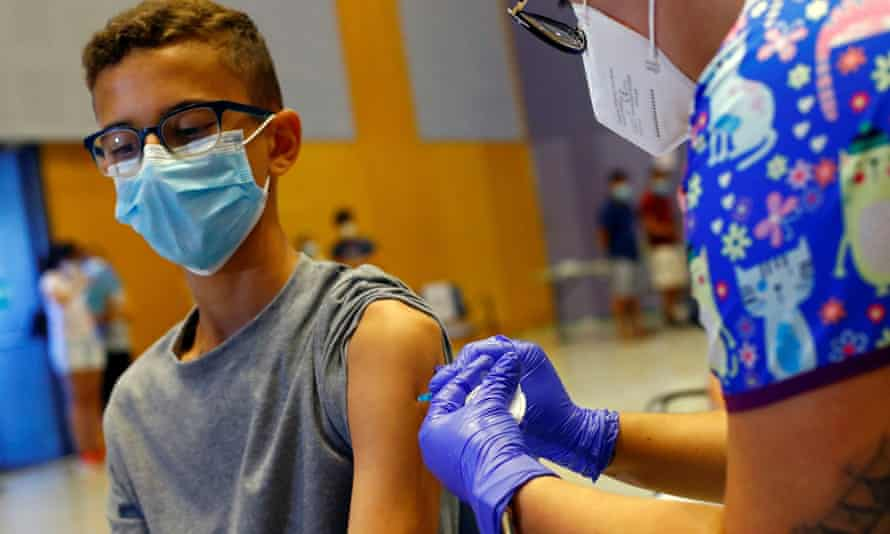 A 14-year-old boy receives the Moderna vaccine in Spain